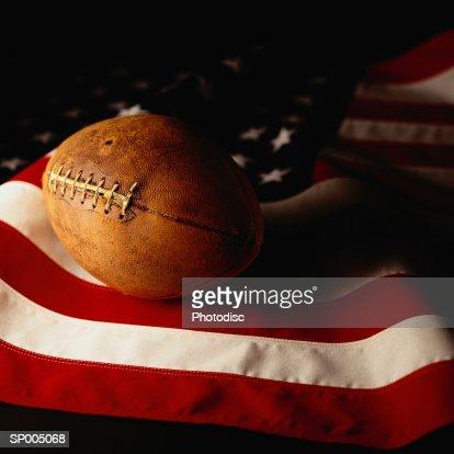 Football on American Flag : Stock Photo