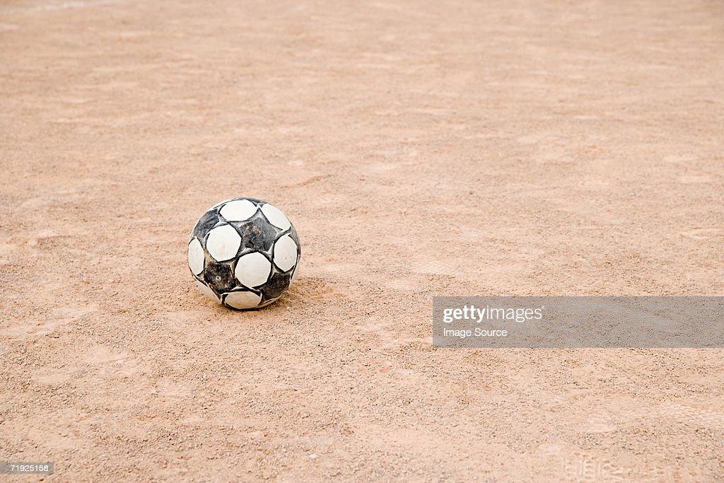 Football on gravel : Stock Photo