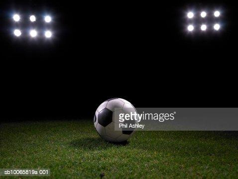 Football on stadium's lawn : Stock Photo
