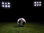 Football on stadium's lawn