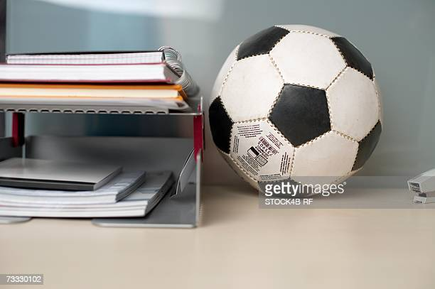 Football on the desktop besides some documents