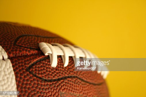 Football on yellow background