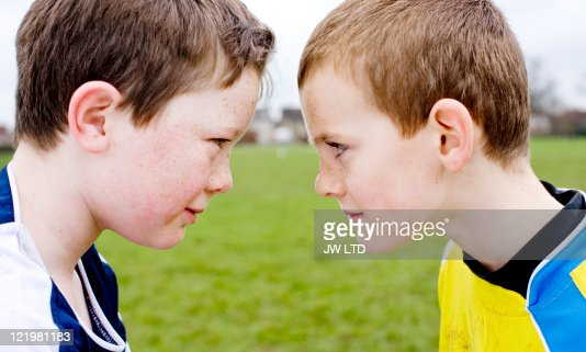 Football opponents face to face : Stock Photo