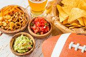 Football party food,  nachos salsa guacamole, copy space