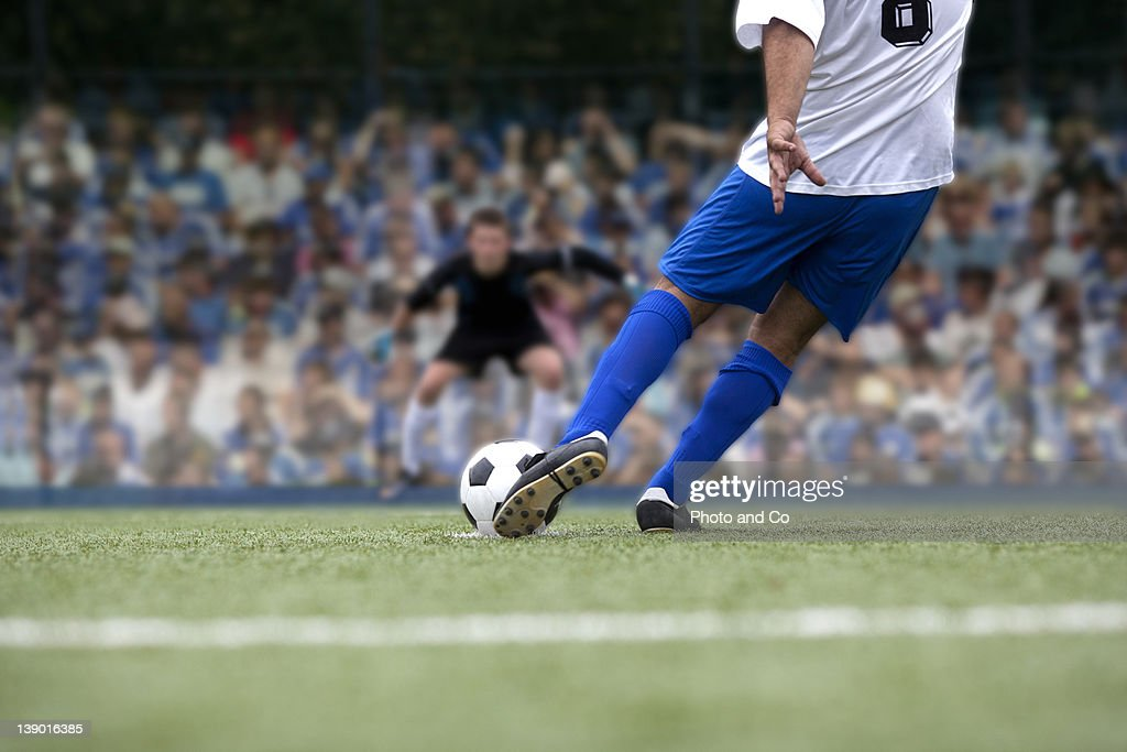 football payer shooting penalty
