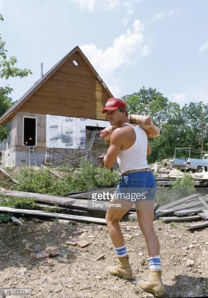 Pittsburgh Steelers Jack Lambert working on his country retreat during photo shoot Mantua PA CREDIT Tony Tomsic