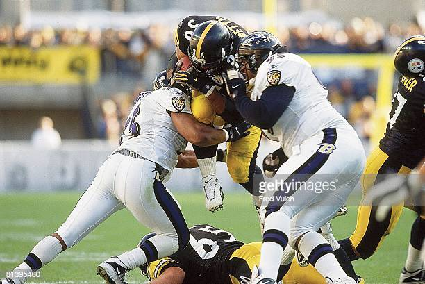 Football Pittsburgh Steelers Jerome Bettis in action vs Baltimore Ravens Jamie Sharper and Sam Adams Pittsburgh PA 11/4/2001