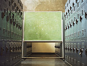 Football play written on chalkboard in locker room