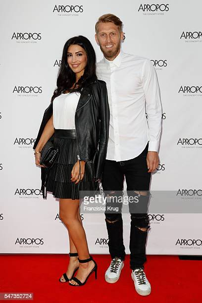 Football player Aaron Hunt und his wife Semra Hunt attend the Apropos Menswear Store Opening in Hamburg on July 14 2016 in Hamburg Germany