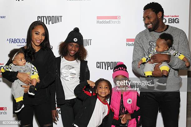 Football player Antonio Cromartie and Terricka Cromartie pose with their children during BKLYN Rocks presented by City Point Kids Foot Locker and...