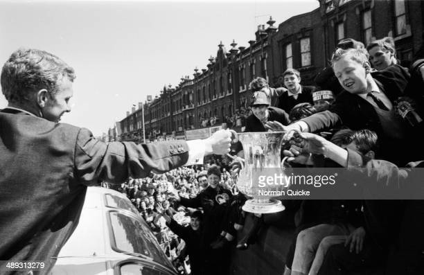 Football player Bobby Moore with the victorious West Ham Football Club greeting the crowds on a parade through London with the F A Cup London May 3rd...