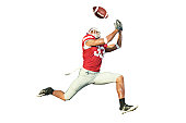 Football player catches ball in midair.