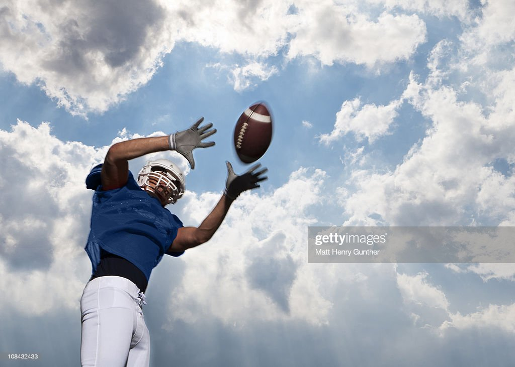 football player catching ball : Stock Photo