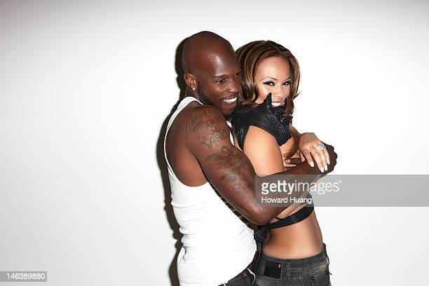 Football player Chad Ochocinco and television personality Evelyn Lozada are photographed for Urban Inkmagazine in June 2012 in New York City
