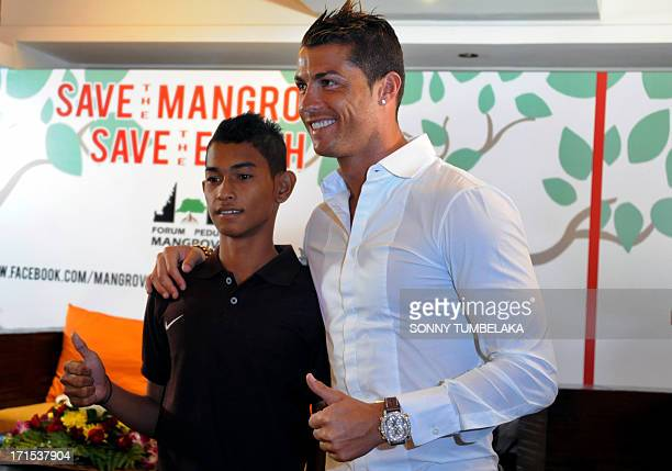 Football player Cristiano Ronaldo is reunited with 16yearold Martunis an Indonesian survivor of the deadly 2004 Aceh tsunami who the Real Madrid star...
