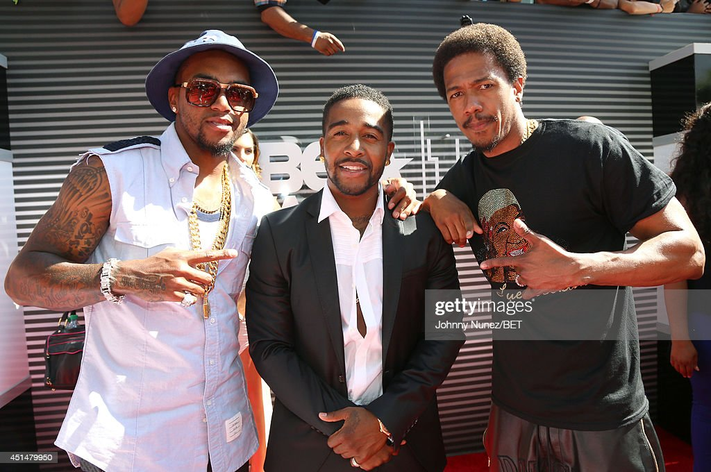NFL football player DeSean Jackson, singer Omarion and actor Nick Cannon attend the BET AWARDS '14 at Nokia Theatre L.A. LIVE on June 29, 2014 in Los Angeles, California.