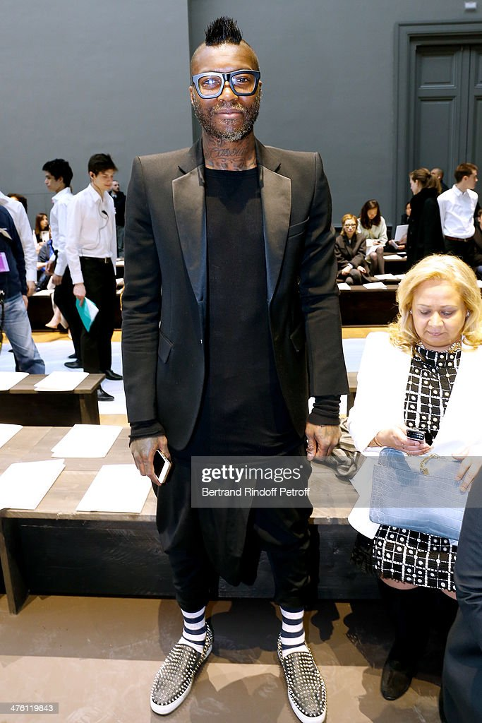 Football player Djibril Cisse attends the Chloe show as part of the Paris Fashion Week Womenswear Fall/Winter 2014-2015. Held at Grand Palais on March 2, 2014 in Paris, France.