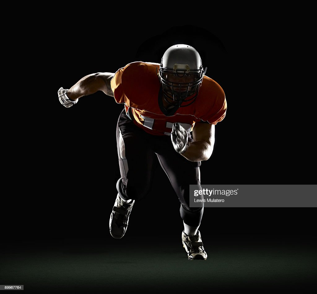 Football player exploding from 3-Point Stance