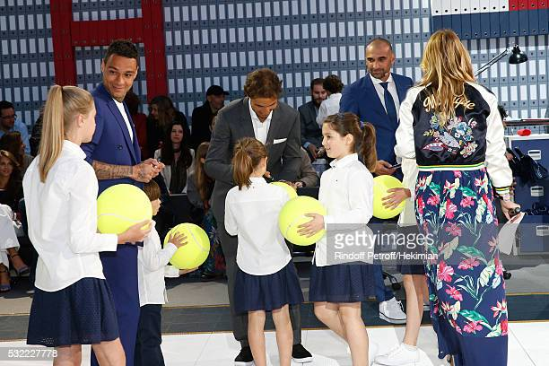 Football player Gregory van der Wiel Tennis player Rafael Nadal Football player Jerome Alonzo and Actress Justine Fraioli sign autographs Tommy...