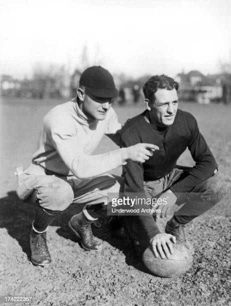 Football player Harold 'Red' Grange in his first year at the University of Illinois with his freshman football coach Bert Ingwerson Urbana Illinois...