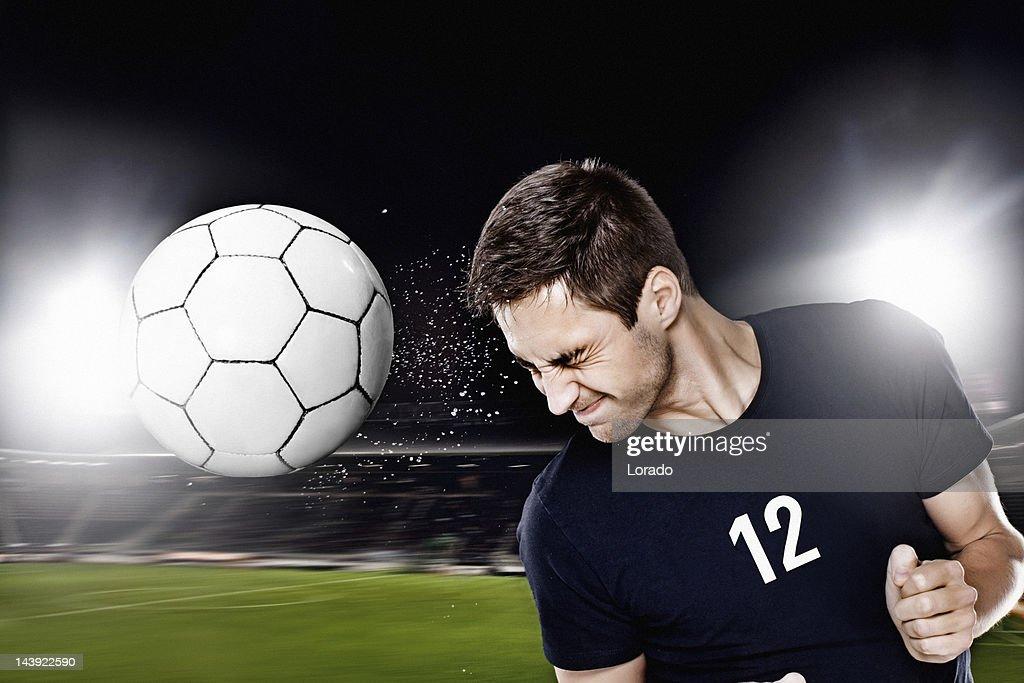 football player heading ball
