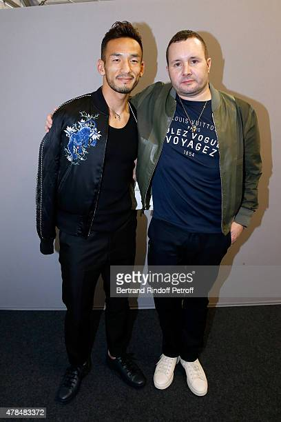Football Player Hidetoshi Nakata and Fashion Designer Kim Jones pose Backstage after the Louis Vuitton Menswear Spring/Summer 2016 show as part of...