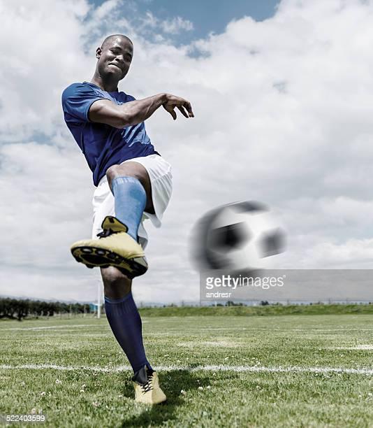 Football player hitting the ball