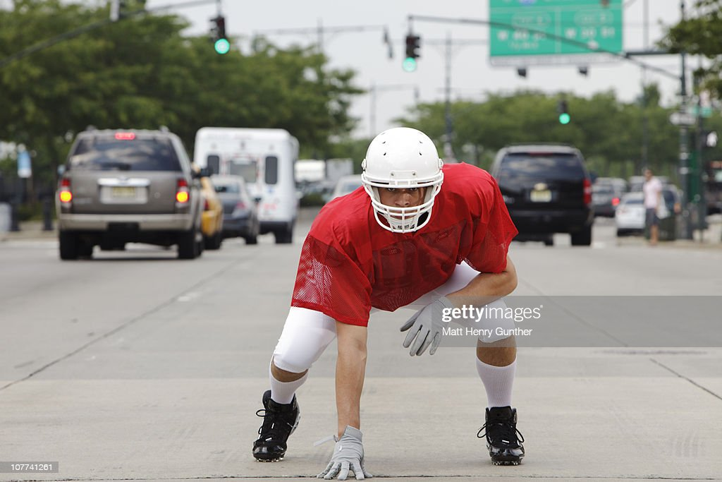 Football player in the streets of New York : Stock Photo