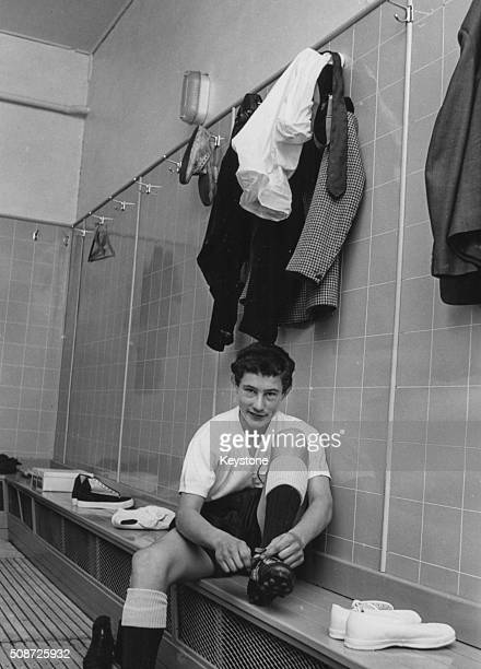 Football player Jimmy Pearce putting on his kit as he prepares to play for Tottenham Hotspur Football Club for the first time London July 23rd 1963