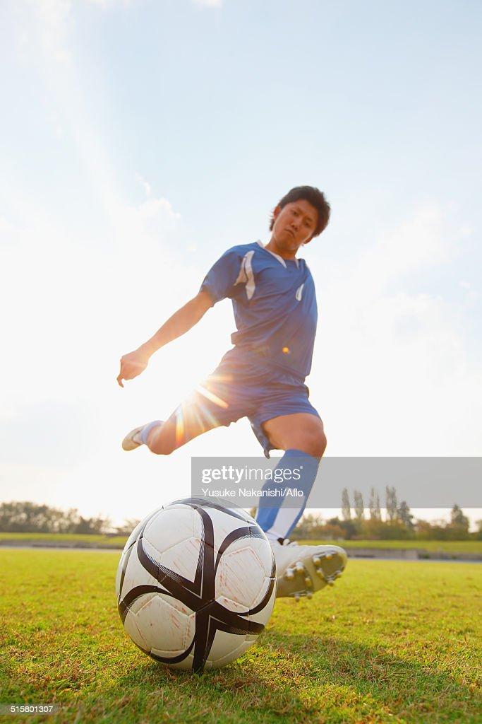 Football player kicking ball