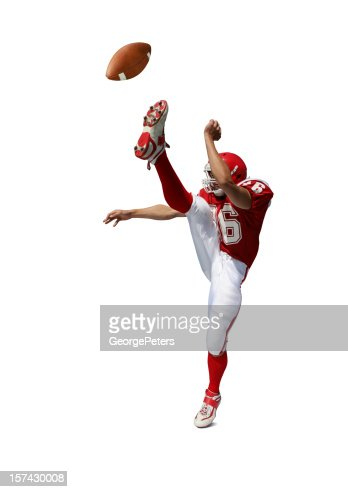 Football Player Kicking Ball with Clipping Path