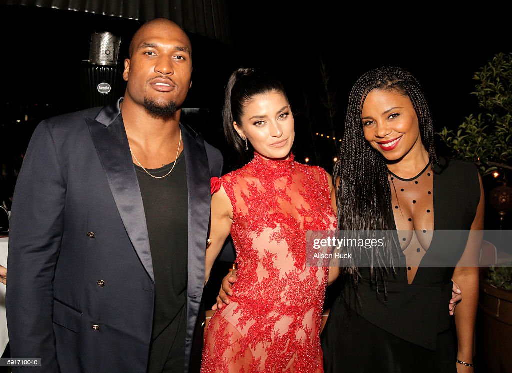 Football player Larry English model Nicole Williams and actress Sanaa Lathan attend the launch of BodyBlendz Mandarin Mist at Petit Ermitage on...