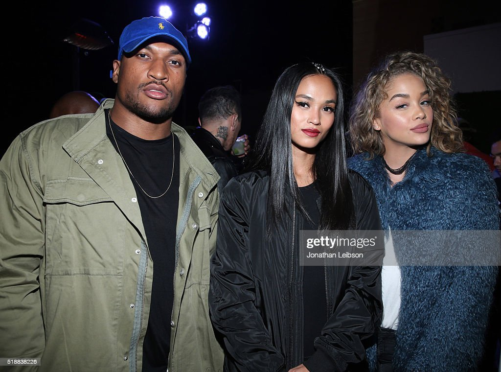Football player Larry English model Sharina Gutierrez and a guest attend STAMPD x PUMA Celebrate SS16 Launch at Hollywood Roosevelt Hotel on April 2...