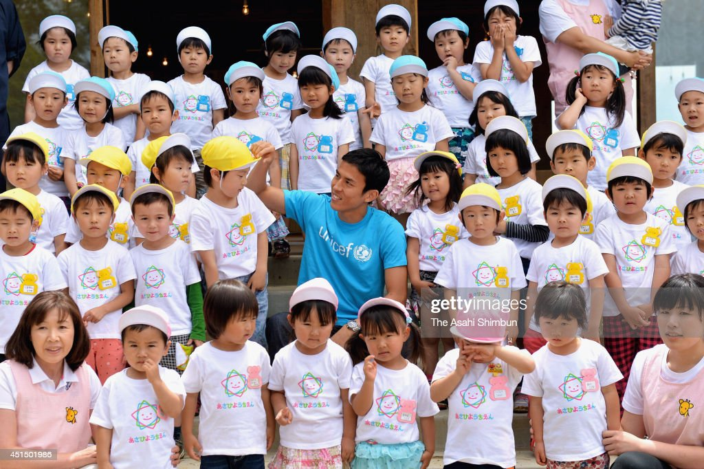 Football player <a gi-track='captionPersonalityLinkClicked' href=/galleries/search?phrase=Makoto+Hasebe&family=editorial&specificpeople=876998 ng-click='$event.stopPropagation()'>Makoto Hasebe</a> (C) poses for photographs with pupils at Asahi Kindergarten during his visit to the tsunami devastated Minamisanriku on June 30, 2014 in MInamisanriku, Miyagi, Japan. Hasebe, had donated 120 million Japanese yen (approximately 1.2 million U.S. dollars) to rebuilt the buildings from his book royalty, visited the kindergarten to appreciate for their support.