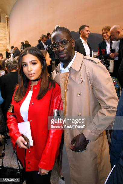 Football player Mamadou Sakho and his wife Majda attend the Chanel Cruise 2017/2018 Collection Show at Grand Palais on May 3 2017 in Paris France