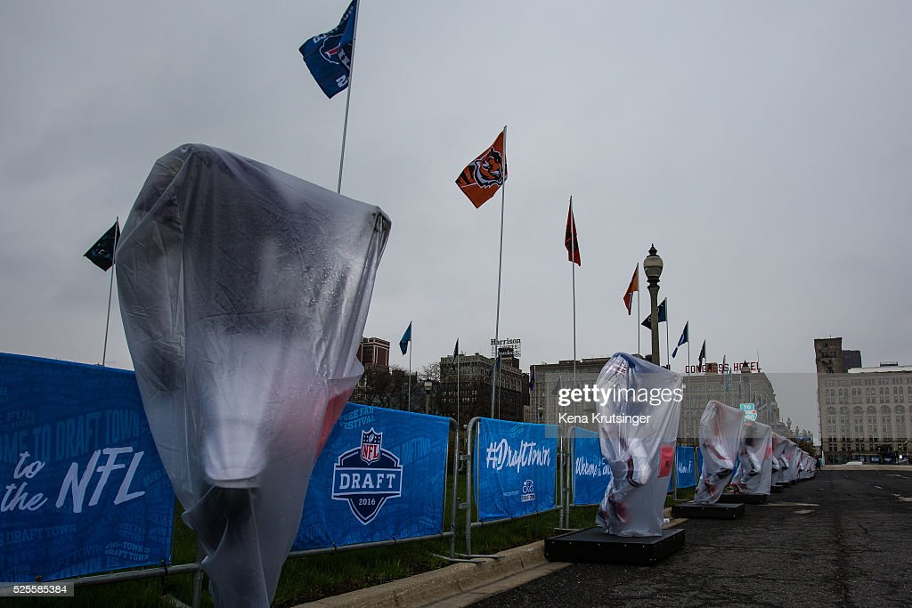 Football player manikins are covered in plastic before the opening of the NFL Draft Town, prior to the start of the 2016 NFL Draft on April 28, 2016 in Chicago, Illinois.
