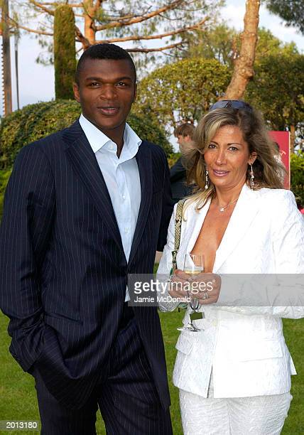 Football player Marcel Desailly and his wife arrive on May 19 2003 at the Laureus Sport for Good Foundation Dinner and Auction held at the Monte...