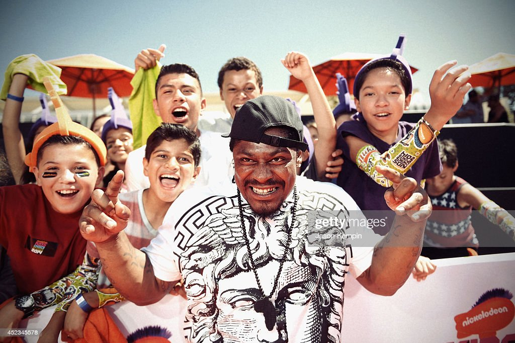 Football player <a gi-track='captionPersonalityLinkClicked' href=/galleries/search?phrase=Marshawn+Lynch&family=editorial&specificpeople=2159904 ng-click='$event.stopPropagation()'>Marshawn Lynch</a> attends Nickelodeon Kids' Choice Sports Awards 2014 on July 17, 2014 in Los Angeles, California.