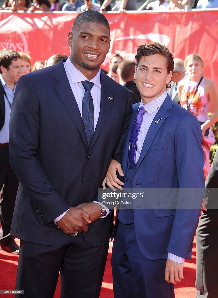 NFL football player <a gi-track='captionPersonalityLinkClicked' href=/galleries/search?phrase=Michael+Sam&family=editorial&specificpeople=7172674 ng-click='$event.stopPropagation()'>Michael Sam</a> and <a gi-track='captionPersonalityLinkClicked' href=/galleries/search?phrase=Vito+Cammisano&family=editorial&specificpeople=12807490 ng-click='$event.stopPropagation()'>Vito Cammisano</a> arrive at the 2014 ESPY Awards at Nokia Theatre L.A. Live on July 16, 2014 in Los Angeles, California.