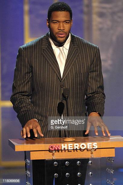 Football player Michael Strahan during CNN Heroes An AllStar Tribute a live global broadcast honoring everyday heroes at the American Museum of...