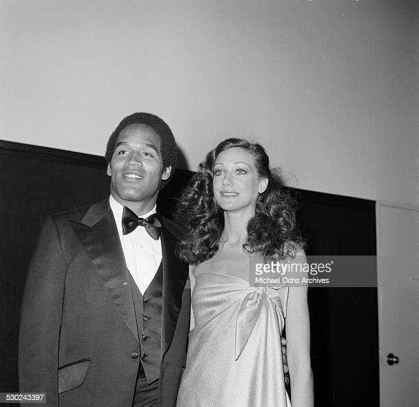 Football player O J Simpson and actress Marisa Berenson attend an event in Los AngelesCA