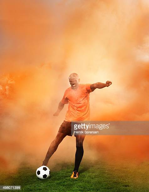 football player orange smoke
