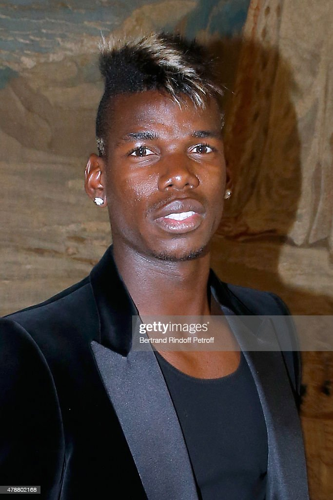 Football Player Paul Pogba attends the Balmain Menswear Spring/Summer 2016 show as part of Paris Fashion Week on June 27, 2015 in Paris, France.