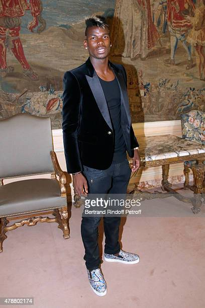 Football Player Paul Pogba attends the Balmain Menswear Spring/Summer 2016 show as part of Paris Fashion Week on June 27 2015 in Paris France