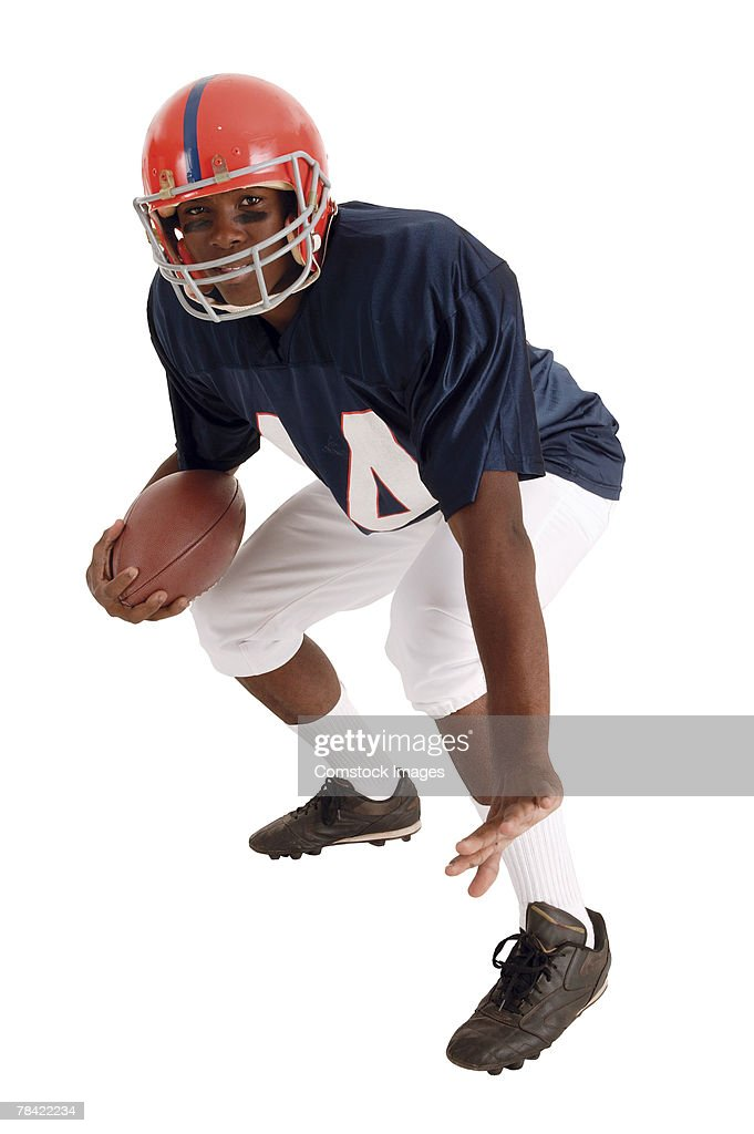 Football player ready with ball : Stock Photo