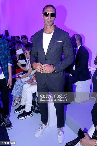 Football Player Rio Ferdinand attends the Louis Vuitton Menswear Spring/Summer 2016 show as part of Paris Fashion Week on June 25 2015 in Paris France