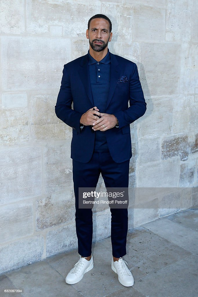 Football player Rio Ferdinand attends the Louis Vuitton Menswear Fall/Winter 2017-2018 show as part of Paris Fashion Week. Held at Palais Royal on January 19, 2017 in Paris, France.