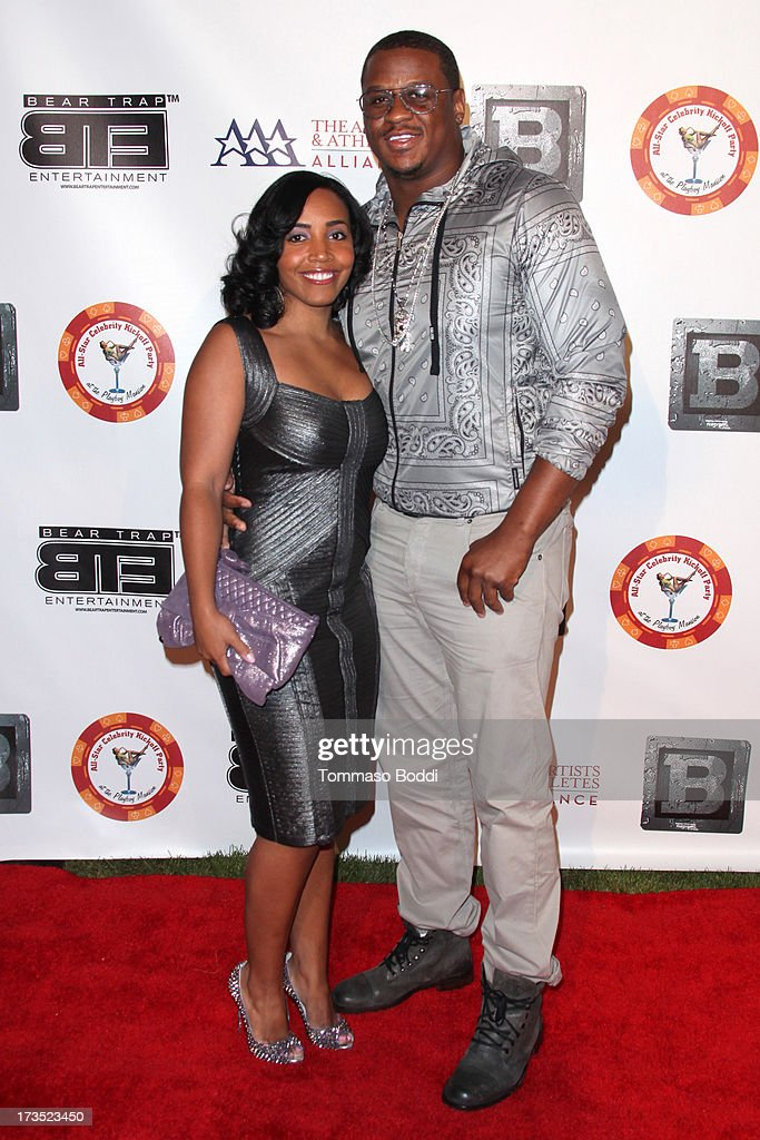 Football player Rob Jackson (R) and guest attend the 8th annual BTE All-Star Celebrity Kickoff Party held at The Playboy Mansion on July 15, 2013 in Beverly Hills, California.