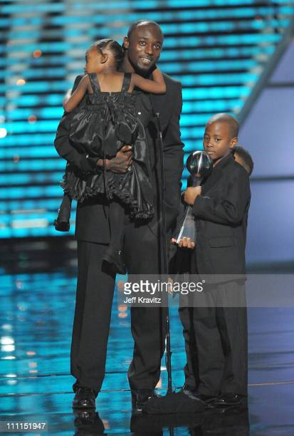 Football player Santonio Holmes and children onstage during the 17th annual ESPY Awards held at Nokia Theatre LA Live on July 15 2009 in Los Angeles...