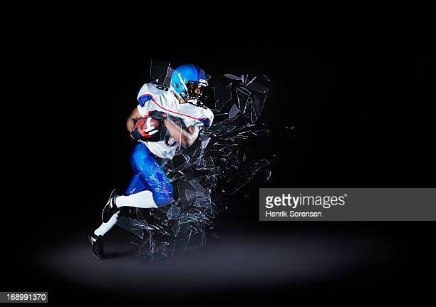 Football player shattering barrier